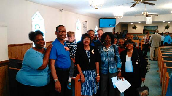 South End Missionary Baptist Church pose for a picture after their autism awareness service.